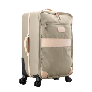 Large 360 wheeled luggage diagonal view in Color 'Tan Coated Canvas'
