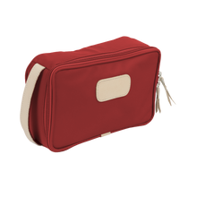 Load image into Gallery viewer, Small Travel Kit - Red Coated Canvas Front Angle in Color 'Red Coated Canvas'