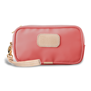 Wristlet - Coral Coated Canvas Front Angle in Color 'Coral Coated Canvas'