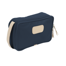 Load image into Gallery viewer, Small Travel Kit - Navy Coated Canvas Front Angle in Color 'Navy Coated Canvas'
