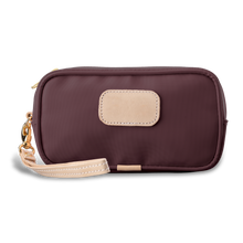 Load image into Gallery viewer, Wristlet - Burgundy Coated Canvas Front Angle in Color 'Burgundy Coated Canvas'
