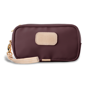 Wristlet - Burgundy Coated Canvas Front Angle in Color 'Burgundy Coated Canvas'
