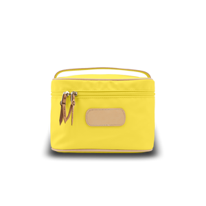 Makeup Case - Lemon Coated Canvas Front Angle in Color 'Lemon Coated Canvas'