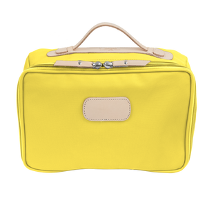 Large Travel Kit - Lemon Coated Canvas Front Angle in Color 'Lemon Coated Canvas'