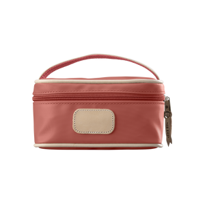 Mini Makeup Case - Coral Coated Canvas Front Angle in Color 'Coral Coated Canvas'