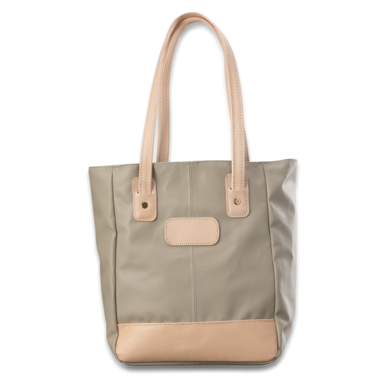 Quality made in America lined durable coated canvas and natural leather tote bag with outside pocket and leather patch to personalize with initials or monogram