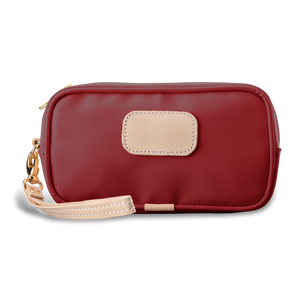 Wristlet - Red Coated Canvas Front Angle in Color 'Red Coated Canvas'