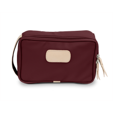 Load image into Gallery viewer, Small Travel Kit - Burgundy Coated Canvas Front Angle in Color 'Burgundy Coated Canvas'
