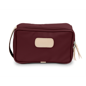 Small Travel Kit - Burgundy Coated Canvas Front Angle in Color 'Burgundy Coated Canvas'