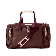 Load image into Gallery viewer, Medium Square Duffel - Burgundy Coated Canvas Front Angle in Color 'Burgundy Coated Canvas'