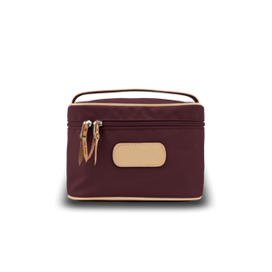 Makeup Case - Burgundy Coated Canvas Front Angle in Color 'Burgundy Coated Canvas'