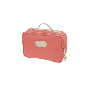 Large Travel Kit - Coral Coated Canvas Front Angle in Color 'Coral Coated Canvas'