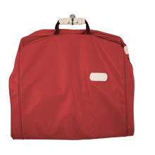 "Load image into Gallery viewer, 50"" Garment Bag - Red Coated Canvas Front Angle in Color 'Red Coated Canvas'"