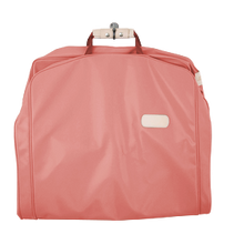 "Load image into Gallery viewer, 50"" Garment Bag - Coral Coated Canvas Front Angle in Color 'Coral Coated Canvas'"