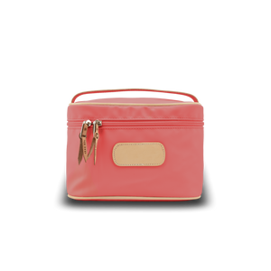 Makeup Case - Coral Coated Canvas Front Angle in Color 'Coral Coated Canvas'