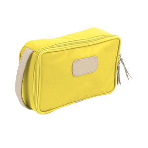 Small Travel Kit - Lemon Coated Canvas Front Angle in Color 'Lemon Coated Canvas'