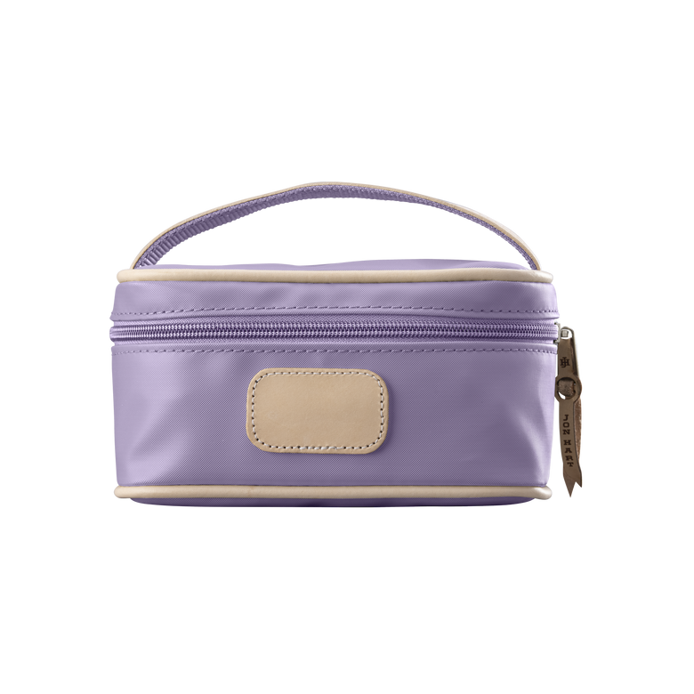 Mini Makeup Case - Lilac Coated Canvas Front Angle in Color 'Lilac Coated Canvas'