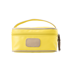 Mini Makeup Case - Lemon Coated Canvas Front Angle in Color 'Lemon Coated Canvas'