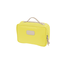 Load image into Gallery viewer, Large Travel Kit - Lemon Coated Canvas Front Angle in Color 'Lemon Coated Canvas'