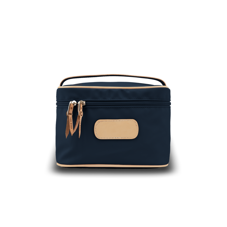 Makeup Case - Navy Coated Canvas Front Angle in Color 'Navy Coated Canvas'