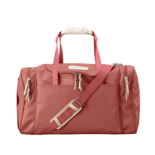 Load image into Gallery viewer, Medium Square Duffel - Coral Coated Canvas Front Angle in Color 'Coral Coated Canvas'