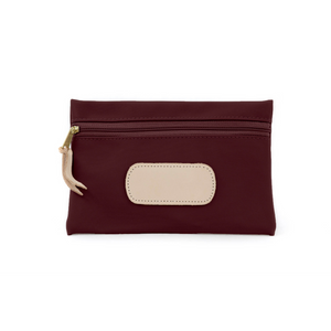 Pouch - Burgundy Coated Canvas Front Angle in Color 'Burgundy Coated Canvas'
