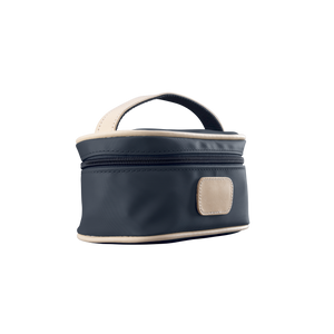 Mini Makeup Case - Navy Coated Canvas Front Angle in Color 'Navy Coated Canvas'