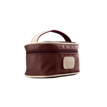 Load image into Gallery viewer, Mini Makeup Case - Burgundy Coated Canvas Front Angle in Color 'Burgundy Coated Canvas'