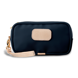 Wristlet - Navy Coated Canvas Front Angle in Color 'Navy Coated Canvas'