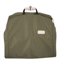 "Load image into Gallery viewer, 50"" Garment Bag - Moss Coated Canvas Front Angle in Color 'Moss Coated Canvas'"