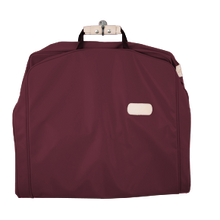 "Load image into Gallery viewer, 50"" Garment Bag - Burgundy Coated Canvas Front Angle in Color 'Burgundy Coated Canvas'"