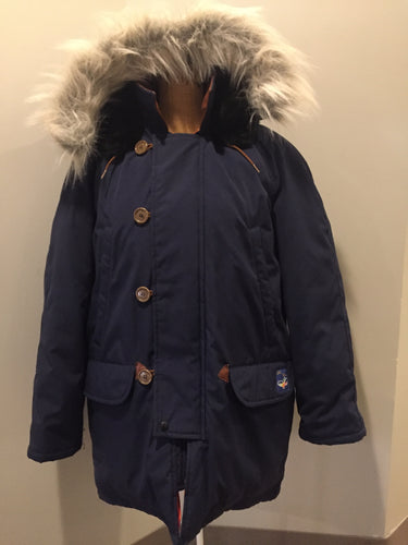 "Kingspier Vintage - Rare Snow Goose parka from the 1970's/1980's (former name of Canada Goose) in navy with leather details and fur trimmed hood, slash pockets, flap pockets, zipper and button closures, ""Snow Goose"" patch on the front pocket, orange lining. Made in Canada. Size 40M."