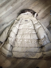 "Load image into Gallery viewer, Kingspier Vintage - Retreat down filled parka in beige with fur trimmed hood, leather trim, slash pockets and flap pockets and zipper closure. Size 37.5"" (chest)."