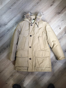 Woolrich goose down parka in beige with fur trimmed hood, slash pockets and flap pockets and inside pocket, zipper and button closures, Size small.
