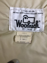 Load image into Gallery viewer, Woolrich goose down parka in beige with fur trimmed hood, slash pockets and flap pockets and inside pocket, zipper and button closures, Size small.