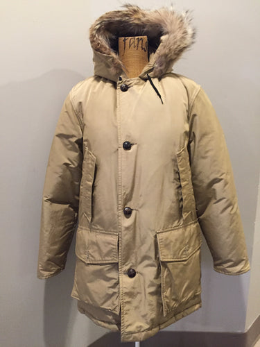 Kingspier Vintage - Woolrich goose down parka in beige with fur trimmed hood, slash pockets and flap pockets and inside pocket, zipper and button closures, Size small.