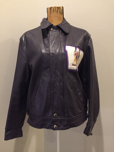 "Western University leather varsity jacket in deep purple with slash pockets and snap closures, emblem embroidered on the chest and ""Western"" written across the back."