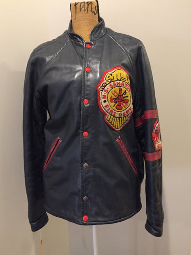 NS Sanitorium Fire Department green leather varsity jacket with red details, snap closures, slash pockets, embroidered emblem on the chest, embroidered monogram on the arm and shearling lining.