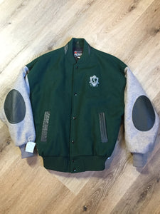 Mayflower Curling wool varsity jacket in green and grey with black leather accents, snap closures, slash pockets and emblem on chest. Made in Canada.