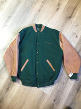 "Load image into Gallery viewer, Piper leather/mouton varsity jacket in green and brown with ""Aviation Limited"" written on the chest and ""Piper"" written on the back, snap closures, slash pockets, quilted lining and inside pocket. Made in Canada."