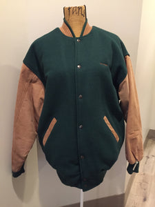 "Piper leather/mouton varsity jacket in green and brown with ""Aviation Limited"" written on the chest and ""Piper"" written on the back, snap closures, slash pockets, quilted lining and inside pocket. Made in Canada."