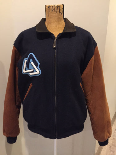 "AES 1997 brown and blue leather and wool varsity jacket with zipper, slash pockets , quilted lining, inside pocket, embroidered emblem on the chest and ""AES"" printed across the back."