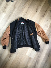 Load image into Gallery viewer, Kingspier Vintage - Trimark black and brown wool/leather varsity jacket with knit trim, snap closures, slash pockets quilted lining and inside pocket. Size large.