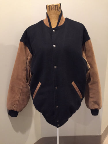 Trimark black and brown wool/leather varsity jacket with knit trim, snap closures, slash pockets quilted lining and inside pocket. Size large.