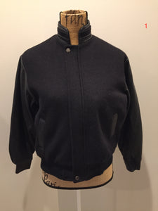 Concord black leather and wool varsity jacket with zipper and snap closures and slash pockets. Size XS.