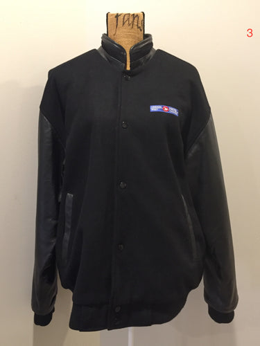 Canada Post uniform leather and wool blend varsity jacket in black with zipper and snap closures and slash pockets. Size large.