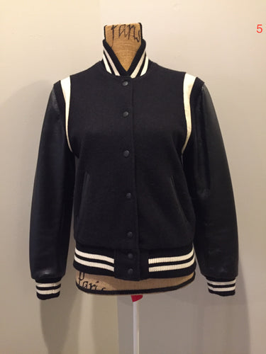 Roots wool and leather black varsity jacket with white stripe details, knit trim, snap closures, slash pockets and inside pocket. Made in Canada. Ladies size S.