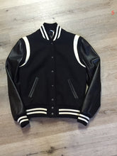 Load image into Gallery viewer, Roots wool and leather black varsity jacket with white stripe details, knit trim, snap closures, slash pockets and inside pocket. Made in Canada. Ladies size S.