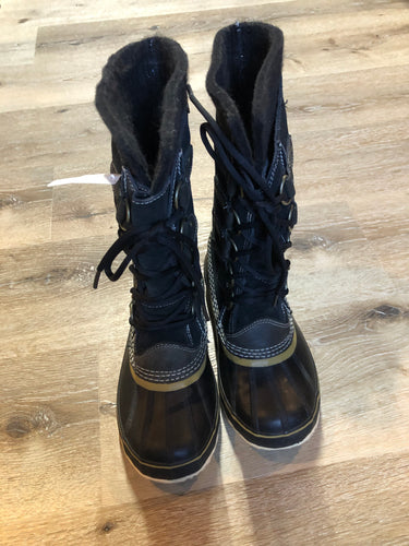 Sorel five eyelet lace up winter storm boots with sheepskin upper, warm recycled polyester blend lining and rubber outsole.  Size 6 US womens  The uppers and soles are in excellent condition.