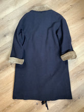 Load image into Gallery viewer, Hilary Radley navy blue 100% pure virgin wool coat with synthetic shearling collar and cuffs , pockets, button closures and a unique front fringe. Size 8.